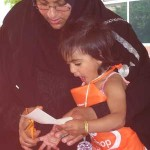 Mother and daughter create a craft during Arab Festival